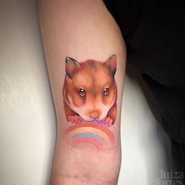 Cute hamster with a pastel coloured rainbow by Luiza last week 🥳 Done at Watermelon Tattoo!