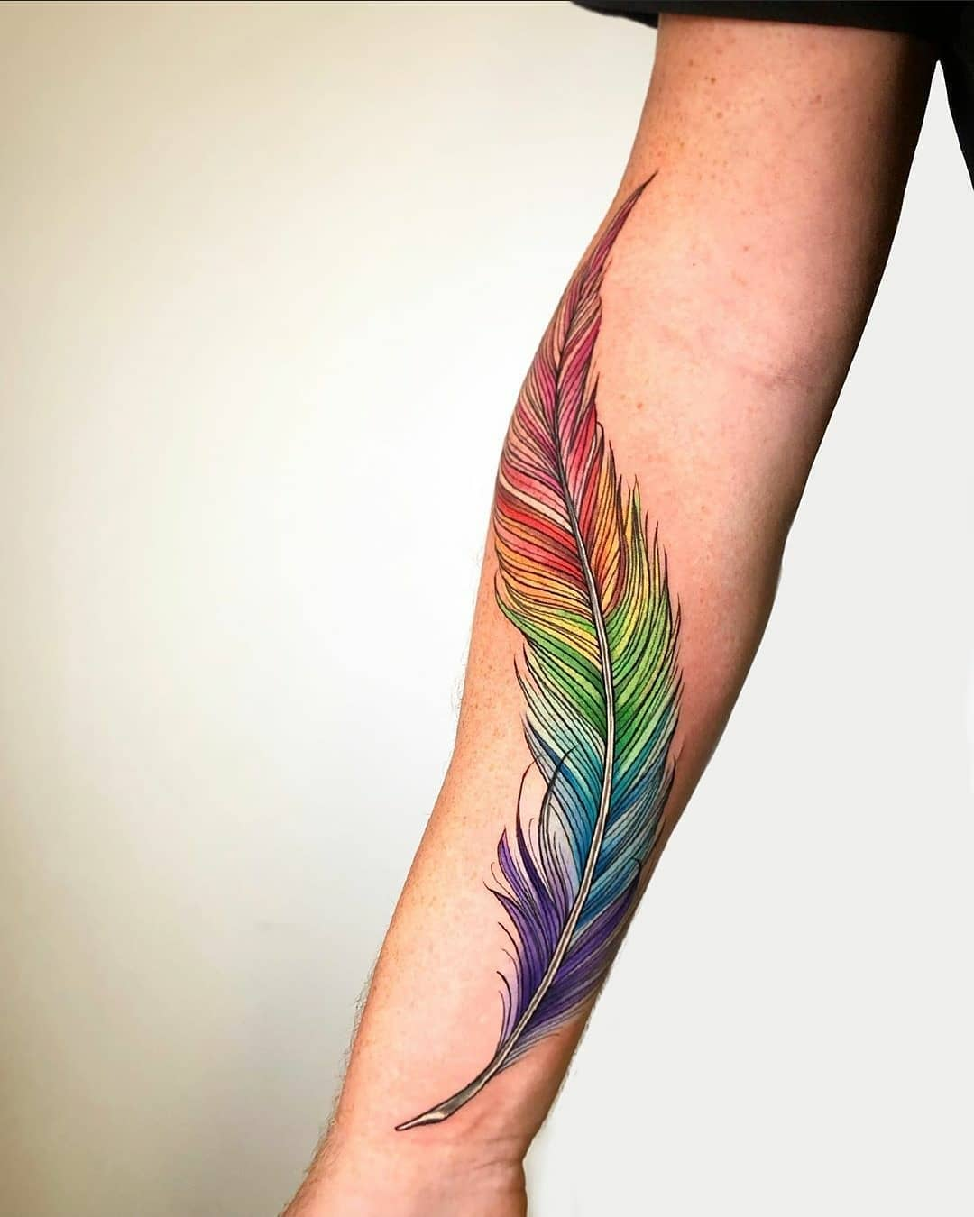 Very colourful feather for Scott's first tattoo! Thanks so much for coming! Tattoo by the one and only Noemi.