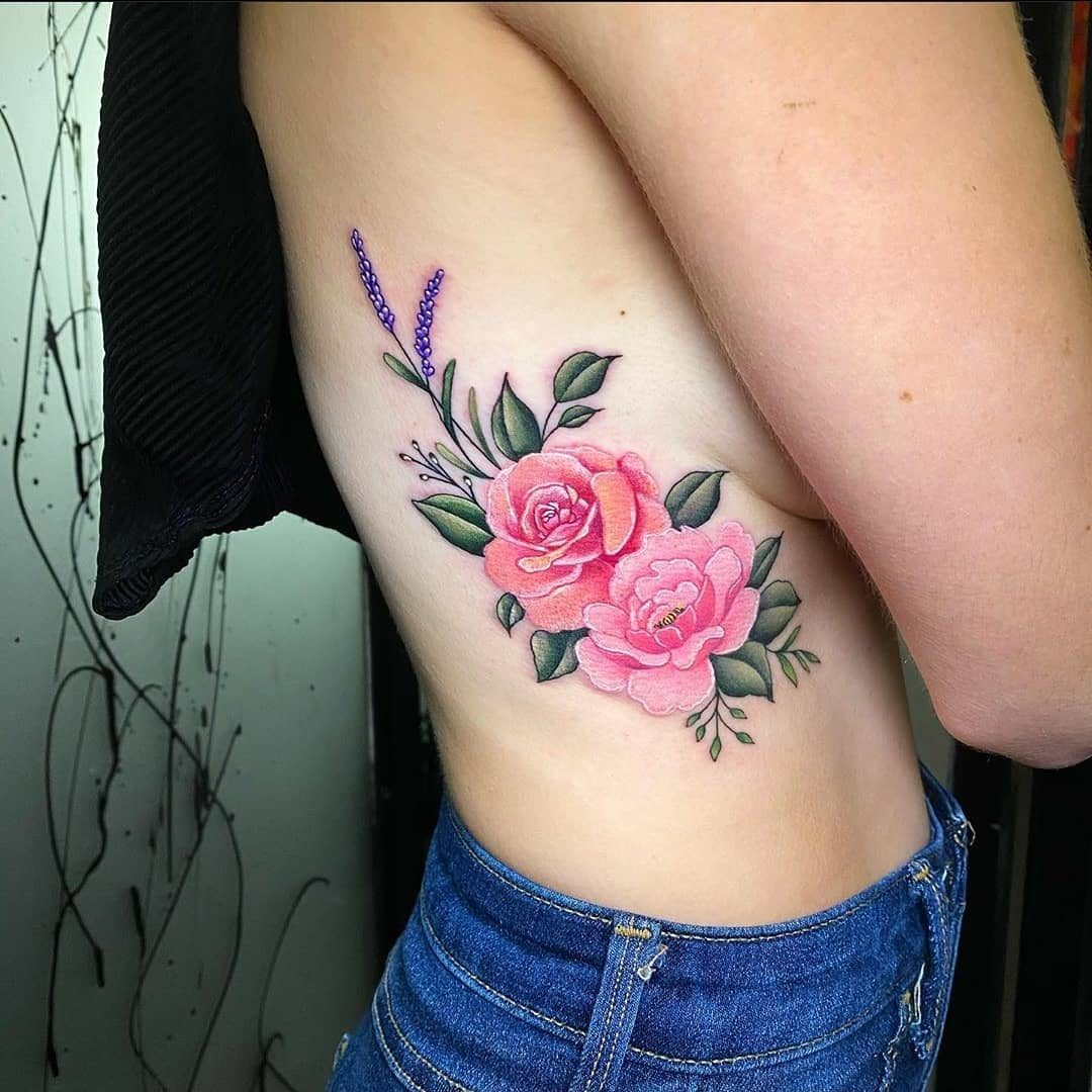 Beautiful floral rib piece by Noemi. Love these!!! noemi_tattoo