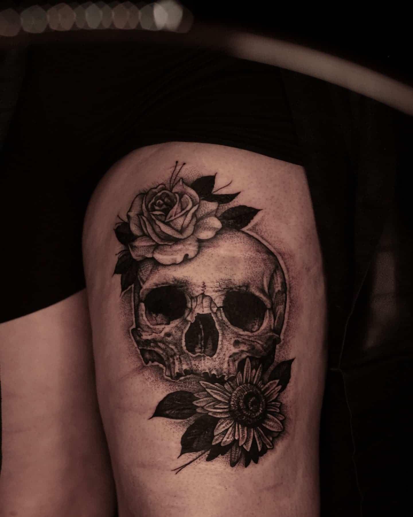 Skull and florals by Liz!  lizminellitattoo